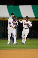 Buffalo Bisons left fielder Michael Saunders (5), center fielder Roemon Fields (37) and right fielder Dwight Smith Jr. (2) celebrate closing out a game against the Pawtucket Red Sox on August 31, 2017 at Coca-Cola Field in Buffalo, New York.  Buffalo defeated Pawtucket 4-2.  (Mike Janes/Four Seam Images)