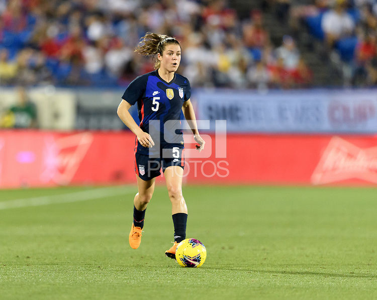 FRISCO, TX - MARCH 11: Kelley O'Hara #5 of the United States looks to pass the ball against Japan during a game between Japan and USWNT at Toyota Stadium on March 11, 2020 in Frisco, Texas.