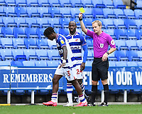 Omar Richards of Reading left receives a yellow card from Referee Gavin Ward   during Reading vs Watford, Sky Bet EFL Championship Football at the Madejski Stadium on 3rd October 2020