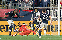 FOXBOROUGH, MA - JULY 18: Teal Bunbury #10 scores against Maxime Crepeau #16 during a game between Vancouver Whitecaps and New England Revolution at Gillette Stadium on July 18, 2019 in Foxborough, Massachusetts.