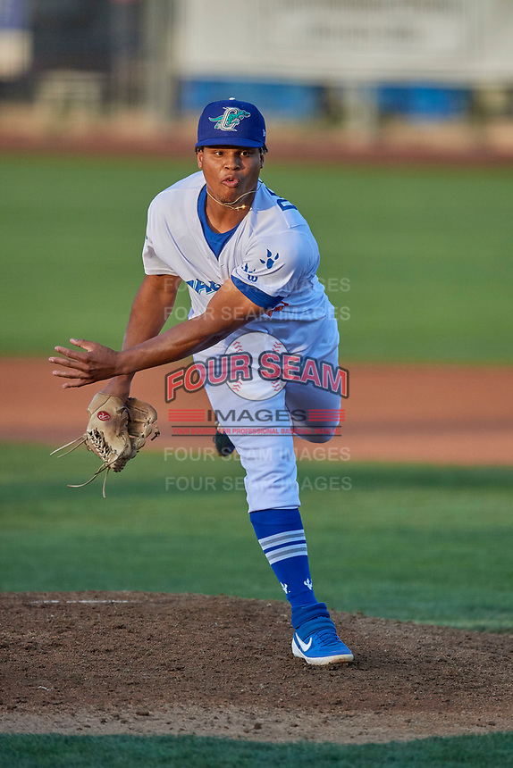 Franklin De La Paz (23) of the Ogden Raptors delivers a pitch to the plate against the Grand Junction Rockies at Lindquist Field on August 28, 2019 in Ogden, Utah. The Rockies defeated the Raptors 8-5. (Stephen Smith/Four Seam Images)