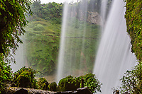 Guizhou Province, China.  Yellow Fruit Tree (Huangguoshu) Waterfall.  View from behind the Falls., looking across to trail on the other side of the river.