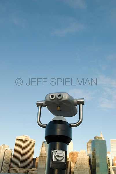 AVAILABLE FROM GETTY IMAGES FOR LICENSING.  Please go to www.gettyimages.com and search for image # 141112704.<br /> <br /> Lower Manhattan Financial District Skyline Viewed from Brooklyn Bridge Park with  Coin Operated Binoculars, New York City, New York State, USA