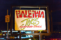 """Haleiwa Joe's Seafood Grill Restaurant"" sign at night in Haleiwa, North Shore, O'ahu."