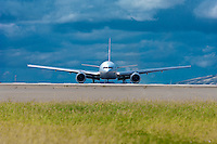 Airplane taxiing on a runway at Kahului Airport, Maui