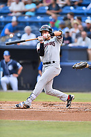 Hickory Crawdads third baseman Chuck Leblanc (10) checks his swing at a pitch during a game against the Asheville Tourists at McCormick Field on July 13, 2017 in Asheville, North Carolina. The Tourists defeated the Crawdads 9-4. (Tony Farlow/Four Seam Images)