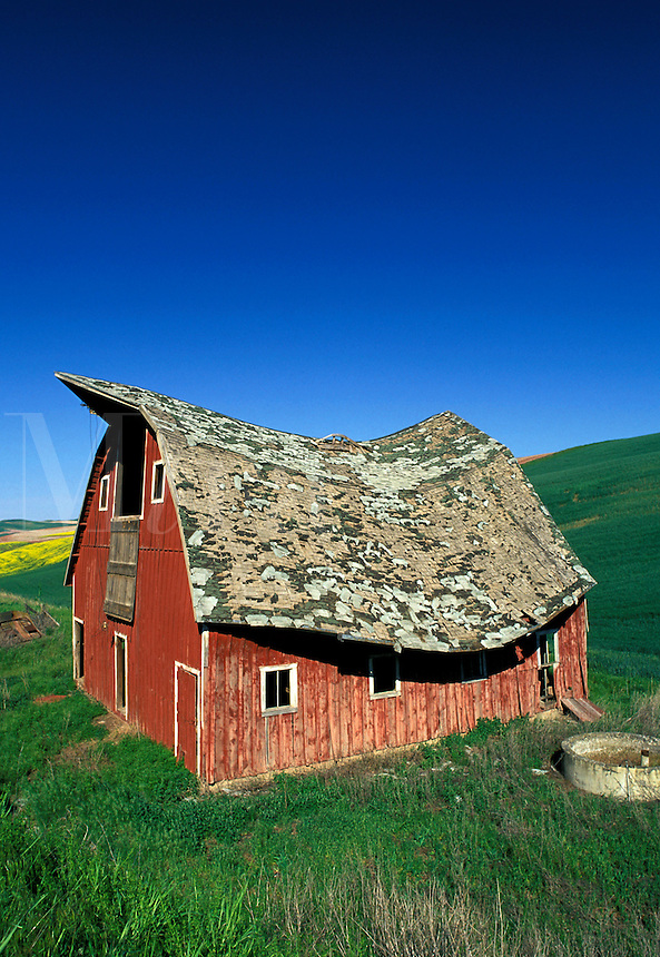 Old red barn beside in countryside, Palouse area, Washington.