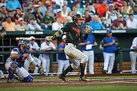 Christopher Barr (17) of the Miami Hurricanes bats during a game between the Miami Hurricanes and Florida Gators at TD Ameritrade Park on June 13, 2015 in Omaha, Nebraska. (Brace Hemmelgarn/Four Seam Images)