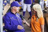 LSU Tigers head coach Paul Mainieri (1) is interviewed in the dugout by CST reporter Kelsey Wingert during the Houston College Classic against the Nebraska Cornhuskers on March 8, 2015 at Minute Maid Park in Houston, Texas. LSU defeated Nebraska 4-2. (Andrew Woolley/Four Seam Images)