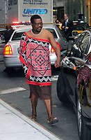 NEW YORK, NY - SEPTEMBER  26:  Mswati III, King of Swaziland and head of the Swazi Royal Family, exits his hotel closely guarded by security as he gets into his car   on September 26, 2011 in New York City.  (Photo By Storms Media Group)<br /> <br /> People:   Mswati III_King of Swaziland