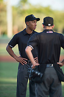 Field umpire Quentin Motte talks to home plate umpire Josh Williams before an Arizona League game against the AZL Dodgers at Camelback Ranch on July 7, 2018 in Glendale, Arizona. The AZL Dodgers defeated the AZL White Sox by a score of 10-5. (Zachary Lucy/Four Seam Images)