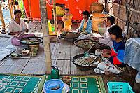 Myanmar, Burma.  Burmese Women of Intha Ethnic Group Making Cheroots, Inle Lake, Shan State.