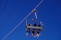 skiing, ski lift, winter, Warren, VT, Vermont, Skiers riding on quad chair lift at Sugarbush Ski Resort in Warren in winter.