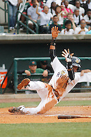 Charleston RiverDogs infielder Abiatal Avelino sliding into home plate during a game against the Augusta GreenJackets at Joseph P.Riley Jr. Ballpark on April 15, 2015 in Charleston, South Carolina. Charleston defeated Augusta 8-0. (Robert Gurganus/Four Seam Images)