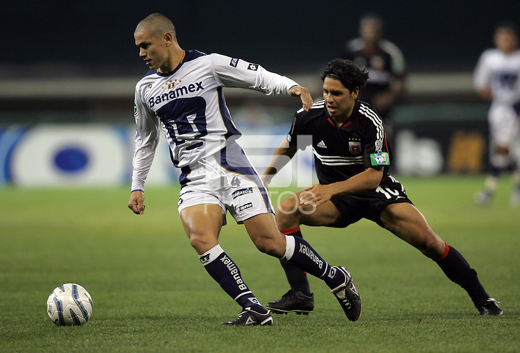 6 April 2005.  DC United's Christian Gomez (10) tries to keep pace with Pumas UNAM defender Dario Veron (4) during a CONCACAF Champion's Cup game at RFK Stadium in Washington, DC.