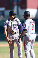 Salt River Rafters third baseman Josh Fuentes (19), of the Colorado Rockies organization, laughs with manager Tommy Watkins (8) during an Arizona Fall League game against the Mesa Solar Sox at Sloan Park on October 30, 2018 in Mesa, Arizona. Salt River defeated Mesa 14-4 . (Zachary Lucy/Four Seam Images)