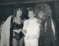 1987 FILE PHOTO - ARCHIVES -<br /> <br /> Too Outrageous star Craig Russel, flanked by La Cage Aux Folles' Kenny Sacha, left, and a Tina Turner look-alike, went home early from a party for his movie at the Royal York on Saturday. Guests were treated to strippers and dancing boys serving food.<br /> <br /> 1987<br /> <br /> PHOTO :  Erin Comb - Toronto Star Archives - AQP