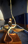 River Thames Waterman Michael Fletcher, docks, pilot guides a Roll on Roll off Ferry from Zeeburger into  Purfleet Thames Terminal,   Essex. 1991