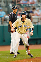 Brett Armour #6 of the Wake Forest Demon Deacons takes his lead off of third base against the Miami Hurricanes at NewBridge Bank Park on May 25, 2012 in Winston-Salem, North Carolina.  The Hurricanes defeated the Demon Deacons 6-3.  (Brian Westerholt/Four Seam Images)