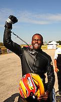 Sept. 25, 2011; Ennis, TX, USA: NHRA pro stock motorcycle rider Michael Phillips celebrates after winning the Fall Nationals at the Texas Motorplex. Mandatory Credit: Mark J. Rebilas-