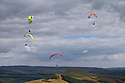16/08/15<br /> <br /> Paragliders take to the air surrounded by dramatic skies as they launch themselves from Mam Tor taking advantage of favourable easterly winds high above Castleton in the Derbyshire Peak District.<br /> <br /> All Rights Reserved - F Stop Press.  www.fstoppress.com. Tel: +44 (0)1335 418365 +44(0)7765 242650