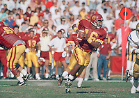 Nov 21, 1987 - Los Angeles, California, USA - USC's Rodney Peete moves away from a UCLA defender during first-half action, Saturday, Nov. 21, 1987 at the Los Angeles Memorial Coliseum in the 57th showdown between the two teams. At the fourth quarter, USC had taken the lead, 17-13..(Credit Image: © Alan Greth)