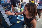 Gabby Cantrell, 9, spins a prize wheel at the Nevada Department of Transportation table during the Epic Rides' Inaugural Carson City Off-Road event on Saturday, June 18, 2016 in Carson City, Nev.<br /> Photo by Kevin Clifford/Nevada Photo Source