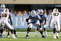 CHAPEL HILL, NC - SEPTEMBER 07: Charlie Heck #67 of the University of North Carolina awaits the snap of the ball during a game between University of Miami and University of North Carolina at Kenan Memorial Stadium on September 07, 2019 in Chapel Hill, North Carolina.