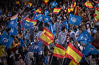 MADRID, SPAIN – MAY 04: Hundreds of people celebrate the victory of the elections in front of the PP headquarters with flags of the PP and Spain on 4 May in Madrid, Spain.  (Photo by Joan Amengual / VIEWpress via Getty Images)