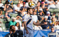 CARSON, CA - SEPTEMBER 29: Dave Romney #4 of the Los Angeles Galaxy heads a ball during a game between Vancouver Whitecaps and Los Angeles Galaxy at Dignity Health Sports Park on September 29, 2019 in Carson, California.