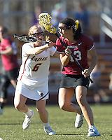 Harvard University midfielder Nina Kucharczyk (13) on the attack as Boston College midfielder Sarah Mannelly (6) defends.
