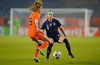 BREDA, NETHERLANDS - NOVEMBER 27: Julie Ertz #8 of the United States defends against approaching Dominique Janssen #15 of the Netherlands during a game between Netherlands and USWNT at Rat Verlegh Stadion on November 27, 2020 in Breda, Netherlands.