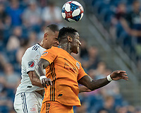 FOXBOROUGH, MA - JUNE 29: Brandon Bye #15, Romell Quioto #31 battle for head ball during a game between Houston Dynamo and New England Revolution at Gillette Stadium on June 29, 2019 in Foxborough, Massachusetts.
