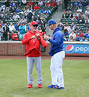 Joe Maddon, Los Angeles manager (left) - David Ross, Chicago Cubs manager (right) - 2020 spring training (Bill Mitchell)