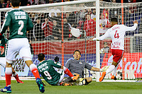 Harrison, NJ - Tuesday April 10, 2018: Alan Pulido, Rodolfo Cota, Tyler Adams during leg two of a  CONCACAF Champions League semi-final match between the New York Red Bulls and C. D. Guadalajara at Red Bull Arena. C. D. Guadalajara defeated the New York Red Bulls 0-0 (1-0 on aggregate).