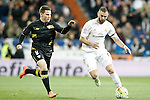 Real Madrid's Karim Benzema (r) and Sevilla's Kevin Gameiro during La Liga match. March 20,2016. (ALTERPHOTOS/Acero)