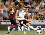 Valencia's Sergio Canales (r) and FC Barcelona's Sergio Busquets during La Liga match.September 1,2013. (ALTERPHOTOS/Acero)