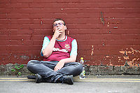 West Ham United fan smokes a cigarette   before the Barclays Premier League match between West Ham United and Swansea City  played at Boleyn Ground , London on 7th May 2016