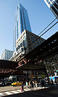 26 JUN 2014 - CHICAGO, USA - Pedestrians cross the road under the tracks of the elevated train system, The L,  in Chicago in the USA (PHOTO COPYRIGHT © 2014 NIGEL FARROW, ALL RIGHTS RESERVED)