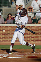 Texas A&M Aggie outfielder Tyler Naquin #18 swings during the NCAA Tournament Regional baseball game against the Dayton Flyers on June 1, 2012 at Blue Bell Park in College Station, Texas. The Aggies defeated the Flyers 4-1. (Andrew Woolley/Four Seam Images).