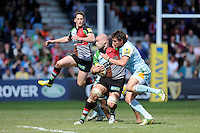 George Robson of Harlequins is tackled by Tom Wood of Northampton Saints as Tom Williams of Harlequins flies past during the Aviva Premiership match between Harlequins and Northampton Saints at the Twickenham Stoop on Saturday 4th May 2013 (Photo by Rob Munro)