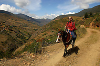 A tourist rides a horse in the Andean mountains. Local guides offer a host of activities to tourists, and tourism has become an important source of income in this area.
