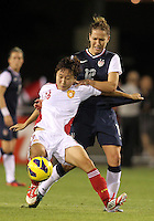 BOCA RATON, FL - DECEMBER 15, 2012: Lauren Cheney (12) of the USA WNT is grabbed by Wang Chen (16) of China WNT during an international friendly match at FAU Stadium, in Boca Raton, Florida, on Saturday, December 15, 2012. USA won 4-1.