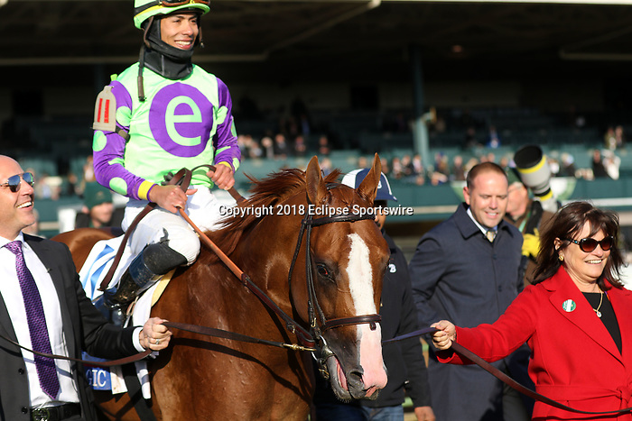 LEXINGTON, KY - APR 07: Good Magic (Jose Ortiz) wins the G2 Toyota Blue Grass Stakes at Keeneland, Lexington, KY. Trainer Chad Brown, owner eFive Racing Thoroughbreds (Robert J. Edwards Jr.) and Stonestreet Stables LLC (Barbara Banke.) By Curlin x Glinda the Good (Hard Spun) Pictured second from right is trainer Chad Brown; Far right (red coat) owner Barbara Banke.(Photo by Mary M. Meek/Eclipse Sportswire/Getty Images)