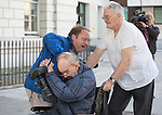 Westminster magistrates court in London 4.9.13<br /> <br /> pic shows: co-accused John Stingemore, 71, a care home manager  - was charged with eight counts of indecent assault, two of taking indecent images of a child and one count of conspiracy to commit buggery. <br /> <br /> seen here attacking photographer outside court.<br /> <br /> <br /> He appeared with Priest Anthony McSweeney lappearing  sex offence charges.<br /> <br /> A Roman Catholic priest from Norfolk is charged on suspicion of sexual offences. He has stood down from the Ministry while investigations are carried out. 66-year-old Father Tony McSweeney - has also resigned as director of one of the biggest schools in Norwic<br /> <br /> Pic by Gavin Rodgers/Pixel 8000 Ltd