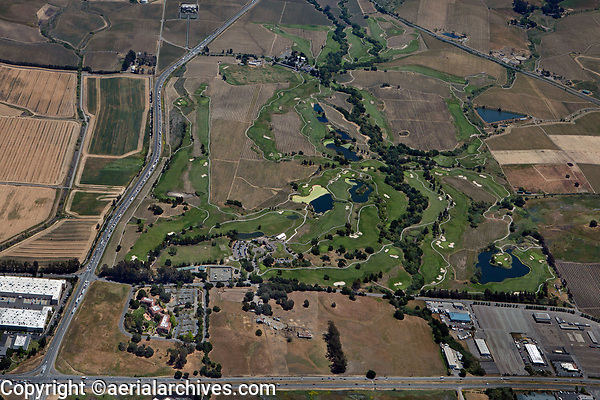 aerial photograph the Eagle Vines Golf Club and Chardonnay Golf Club, American Canyon, Napa County, California; intersection of Highway 29 and Highway 12 at the foreground left