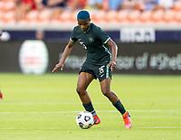 HOUSTON, TX - JUNE 13: Rasheedat Ajibade #15 of Nigeria dribbles the ball during a game between Nigeria and Portugal at BBVA Stadium on June 13, 2021 in Houston, Texas.
