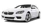 Low aggressive front three quarter view of a 2012 Bmw SERIES 6 Gran Coupe 640i 4 Door Sedan 2WD