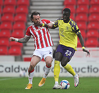 Huddersfield Town's Mouhamadou Naby Sarr battles with  Stoke City's Steven Fletcher<br /> <br /> Photographer Mick Walker/CameraSport<br /> <br /> The EFL Sky Bet Championship - Stoke City v HUddersfield Town - Saturday 21st November 2020 - bet365 Stadium - Stoke<br /> <br /> World Copyright © 2020 CameraSport. All rights reserved. 43 Linden Ave. Countesthorpe. Leicester. England. LE8 5PG - Tel: +44 (0) 116 277 4147 - admin@camerasport.com - www.camerasport.com