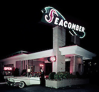 Couple getting out of their 1959 car at the entrance of the Seacomber Motel in Atlantic City, NJ.